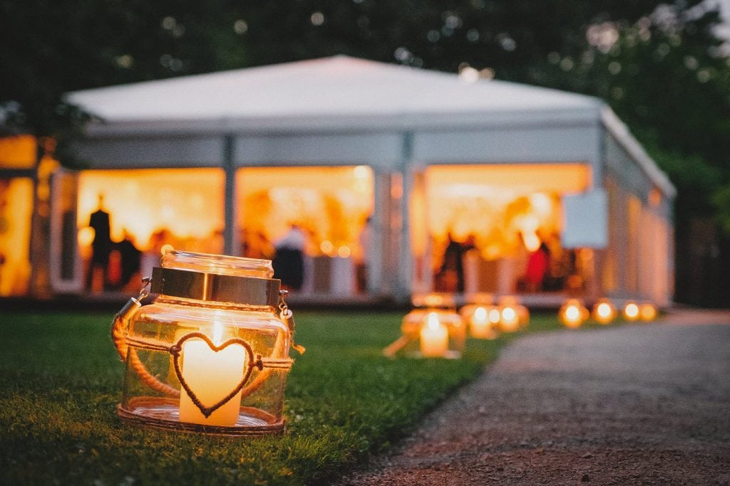 candles light the way to the wedding breakfast marquee