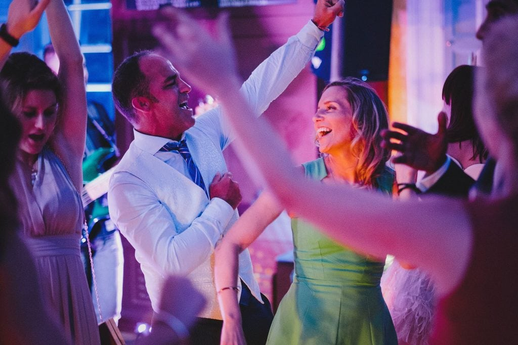 guests dancing together during a wedding reception