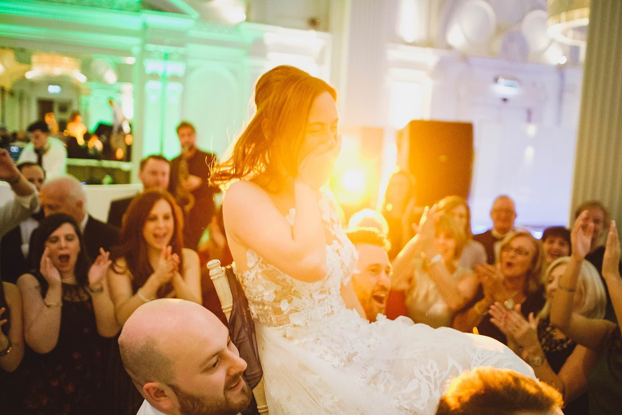 bride lifted up during jewish wedding dance at the andaz hotel