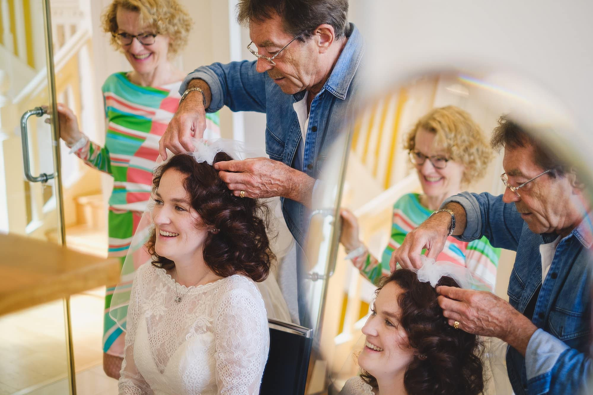 mother of the bride reacts during bridal prep