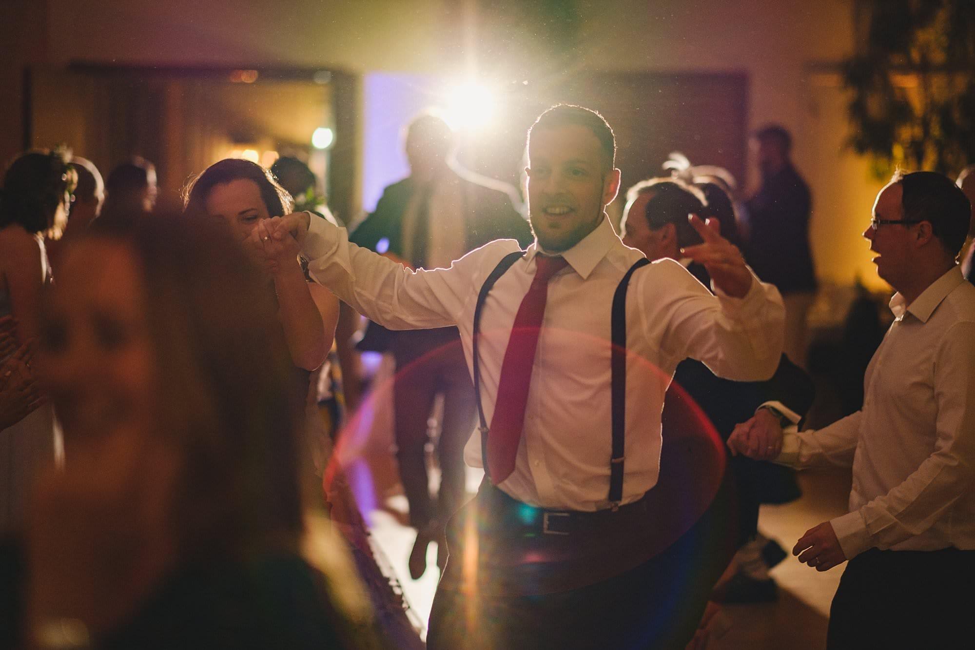 ceilidh dancing at a hurlingham club wedding