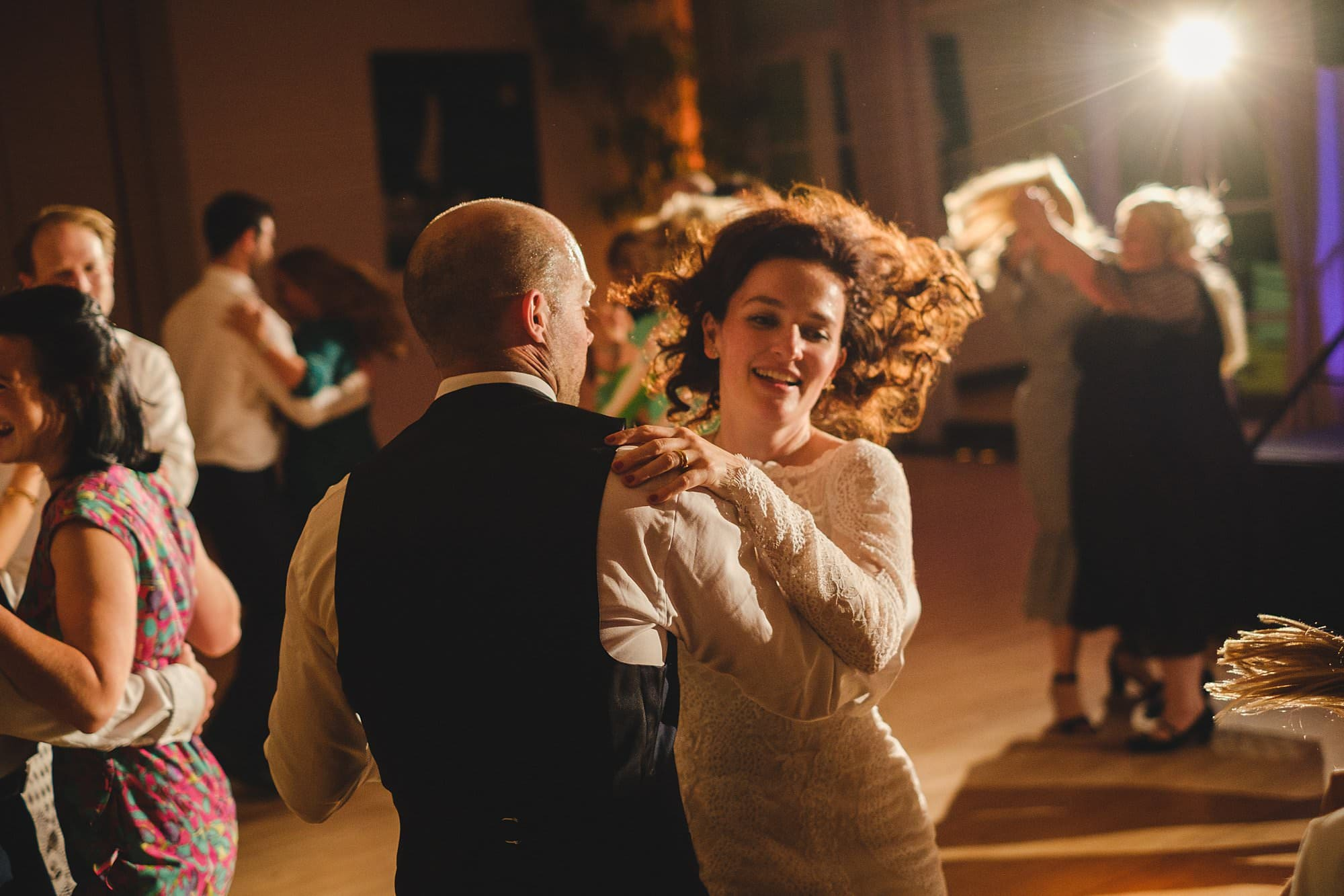 bride and groom ceilidh dancing at a hurlingham club wedding