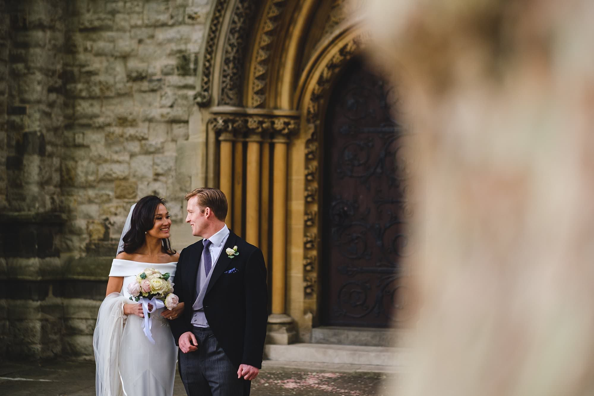 bride and groom portraits at st mary abbots church in london