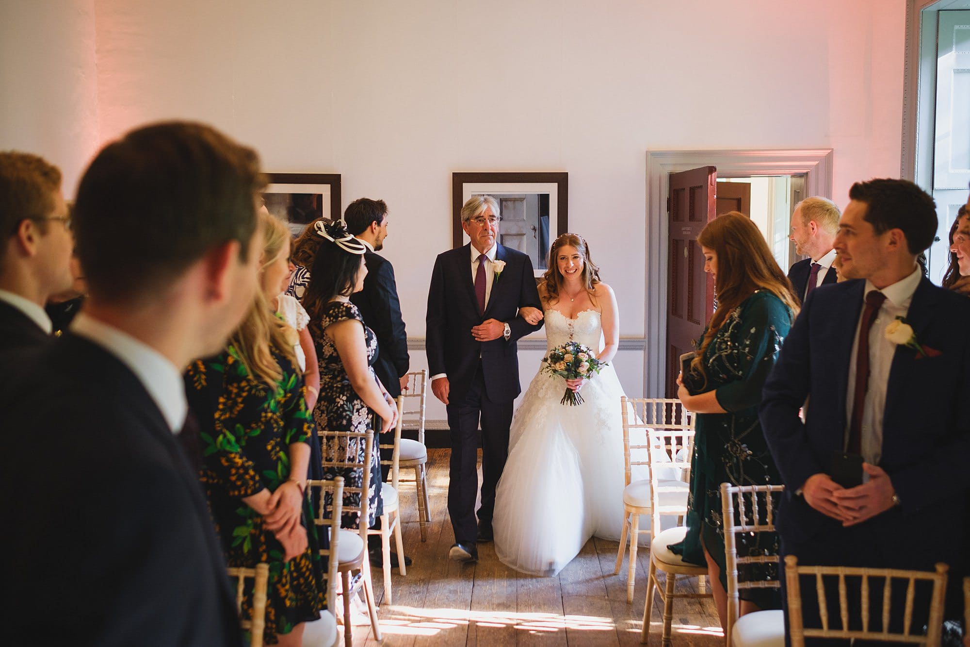 bride and her father walking down the aisle at a Fulham Palace wedding