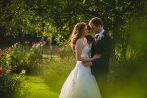 newlyweds have a quiet moment together in Fulham palace's walled garden