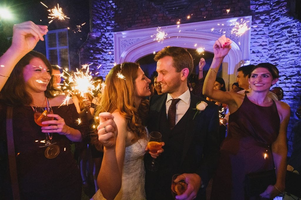 a sparkler parade at a fulham palace wedding reception