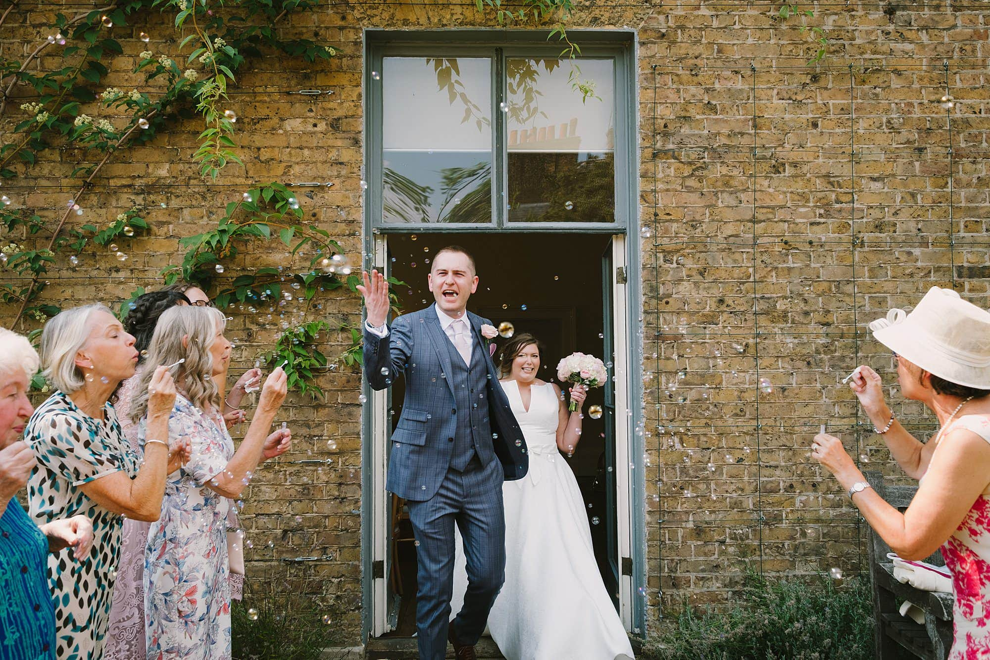 bubbles after a wedding ceremony at cambridge cottage in kew gardens