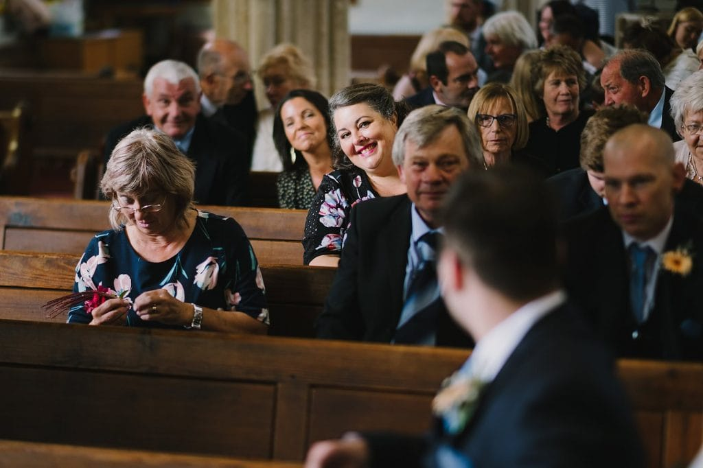 waiting for the wedding to begin at St Lawrence Church in Lechlade