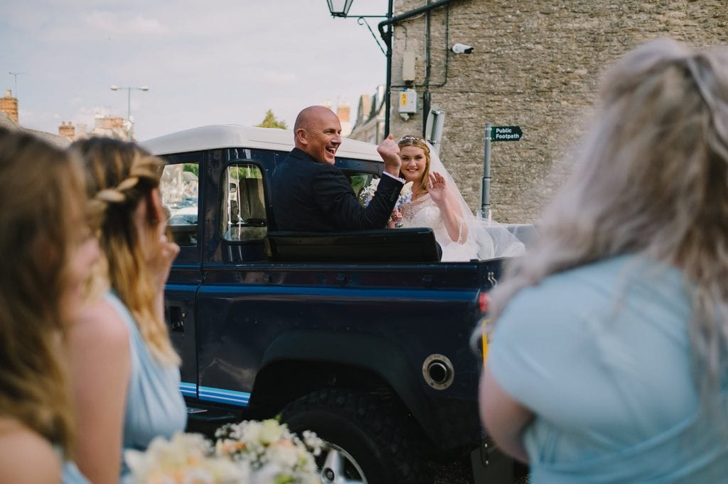 the bride arrives at st lawrence church for her lechlade wedding