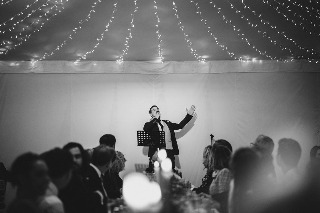 the best man welcomes everyone during his speech at a Fulham Palace wedding