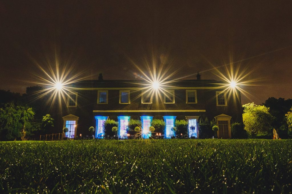 Fulham Palace all lit up by night during a wedding