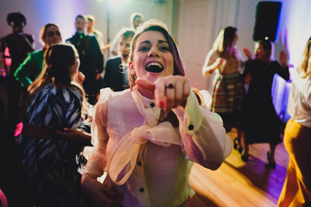 a wedding guest enjoying the party on the dancefloor at Fulham Palace