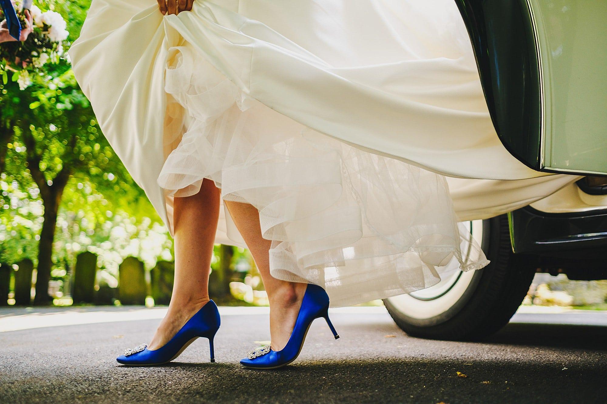bride wearing Manolo blahnik shoes getting out of rolls Royce