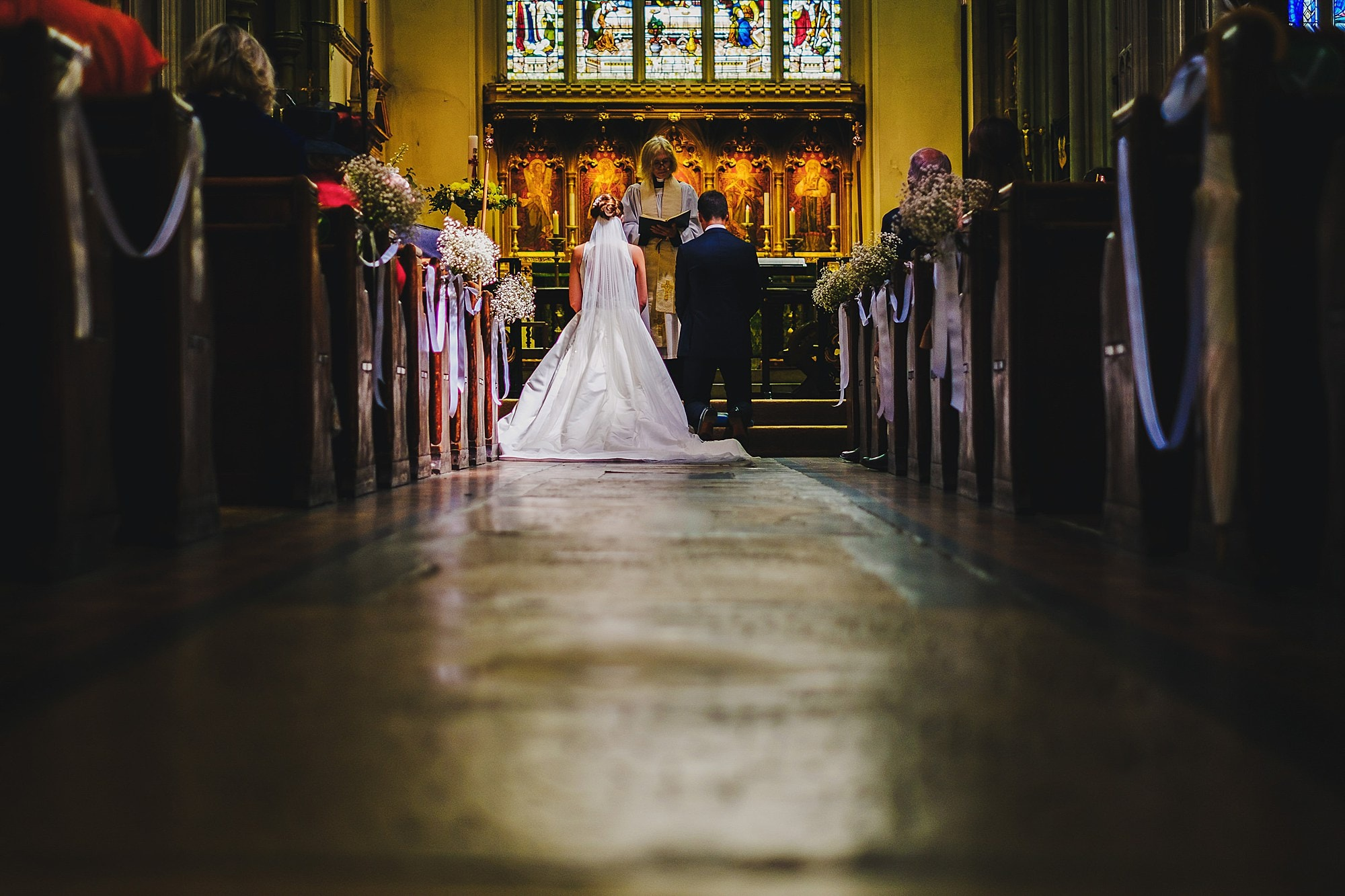 bride and groom at all saints church Fulham
