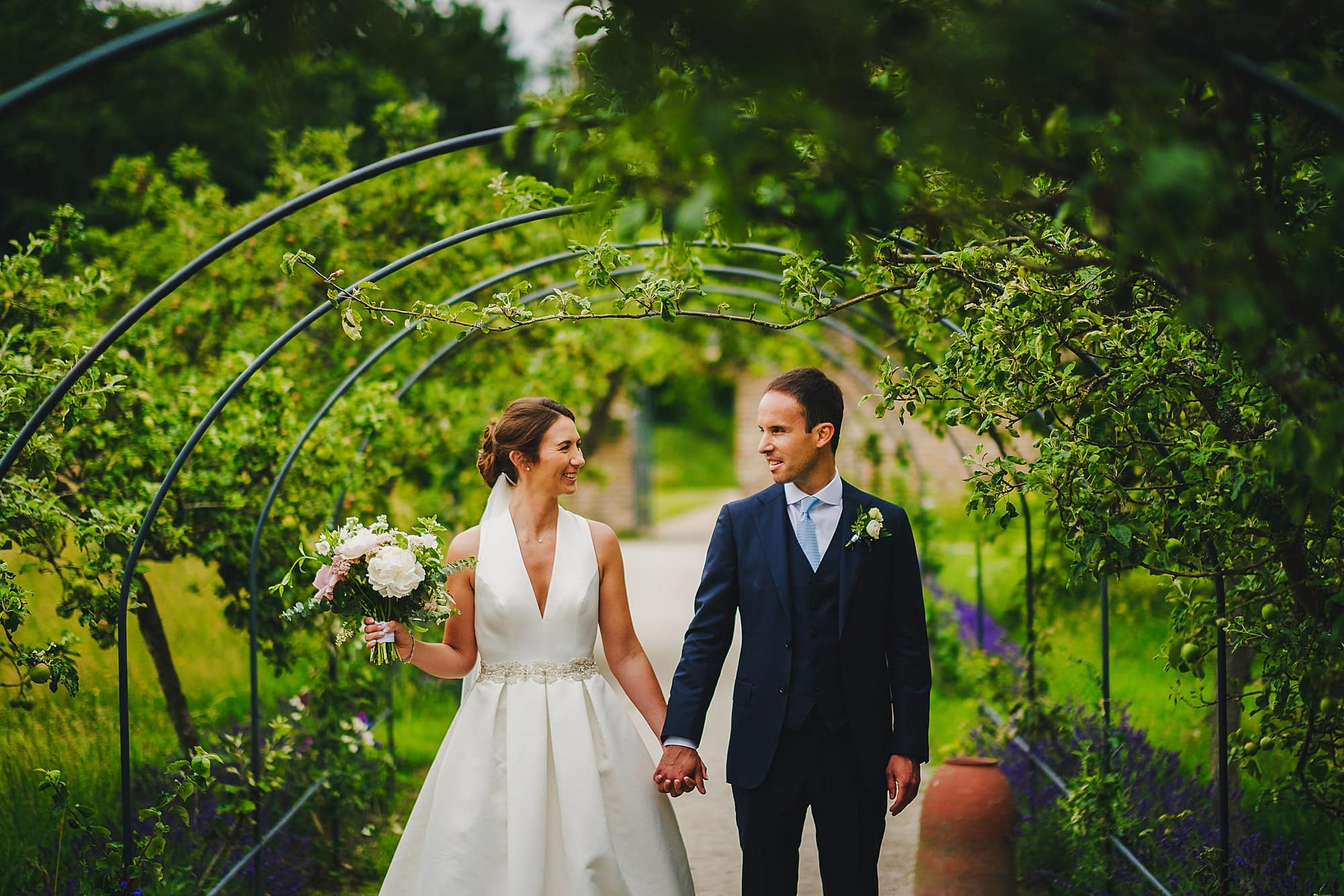 bride and groom portrait in Fulham Palace walled garden