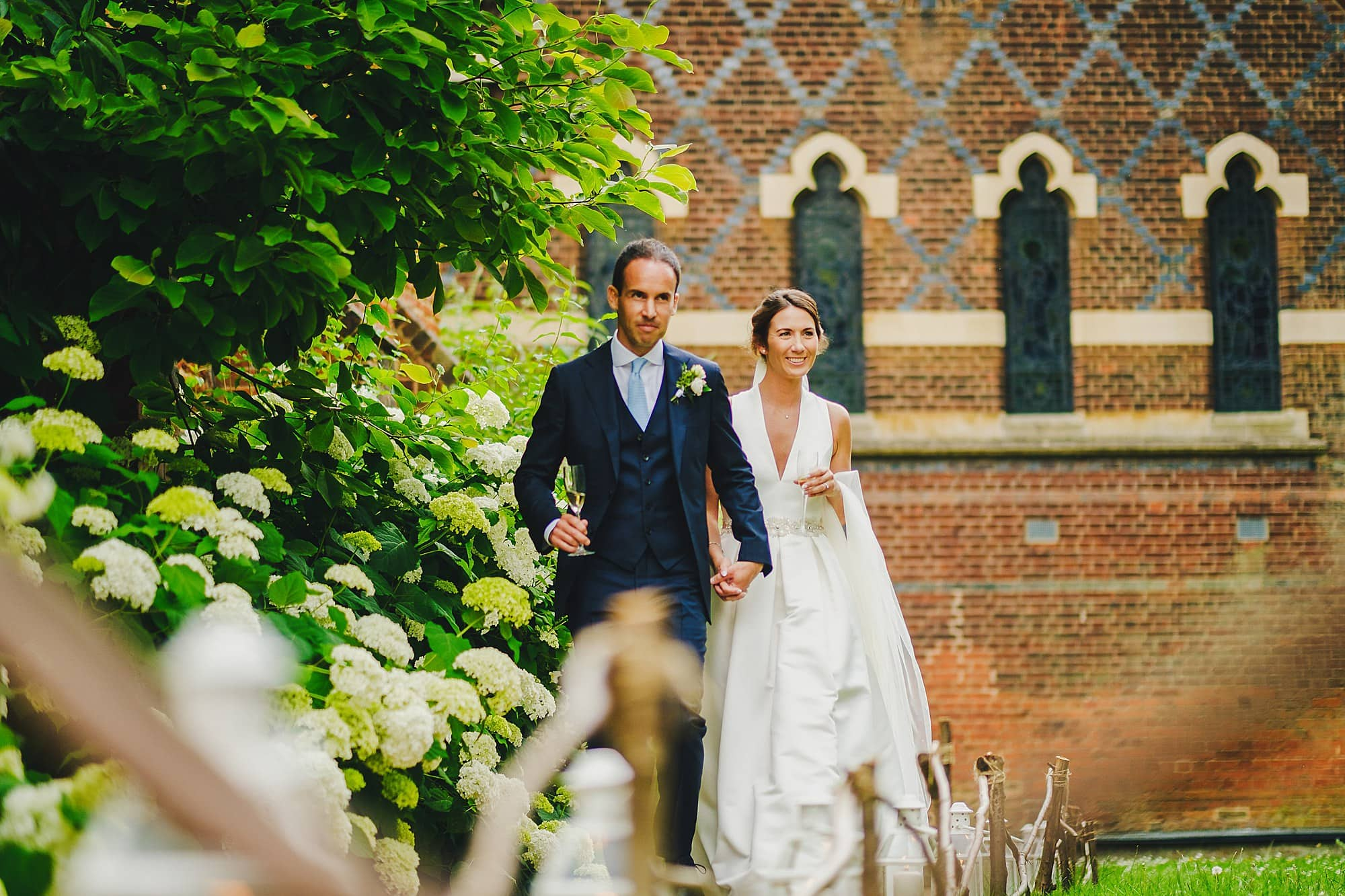 bride and groom make their entrance for the wedding breakfast at Fulham Palace